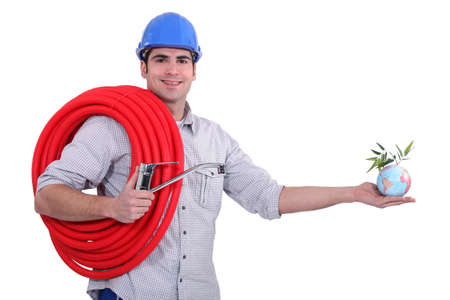 maintenance fitter: Plumber holding coil and globe