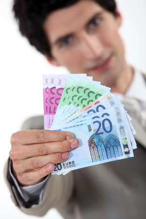 payday: Businessman holding bank notes