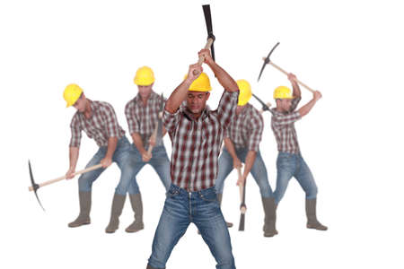 pickaxe: Photo-montage of a laborer using pickaxe Stock Photo