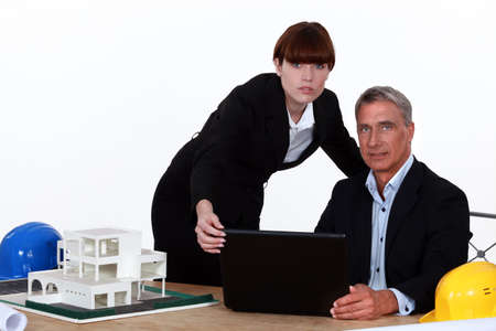 Architect and assistant working on housing project photo