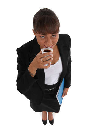 high angle shot: attractive young businesswoman having coffee Stock Photo