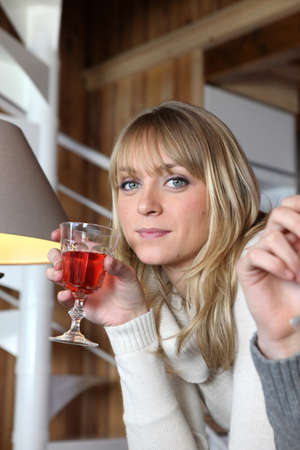 Woman drinking a glass of wine Stock Photo - 13380051