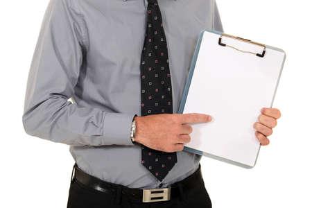 Man pointing at blank clip-board photo