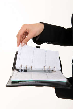 appointment book: A cropped picture of a businesswoman holding  a planner
