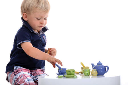 little boy playing with a doll Stock Photo - 13378024