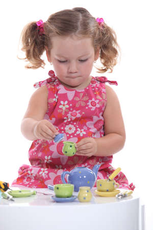 little girl playing at tea party photo