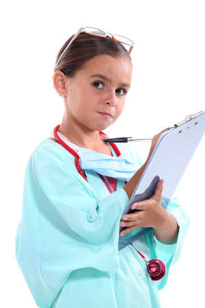 portrait of a little girl in nurse uniform photo