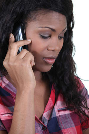 conflicted: a black woman at phone