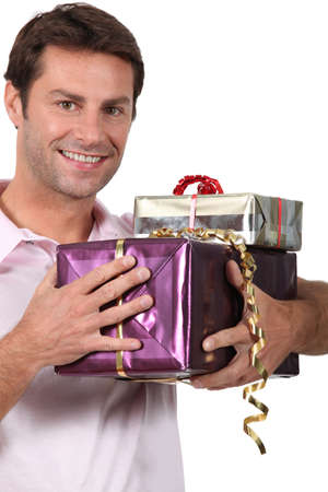 wrapped present: Man holding gifts