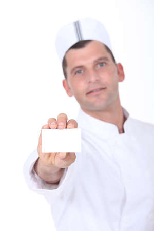 Chef holding up a blank business card Stock Photo - 13377417
