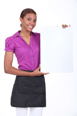 Businesswoma stood with blank poster photo
