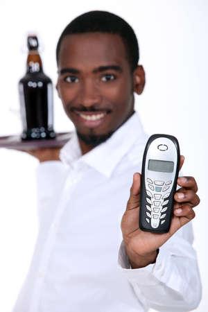 waiter with telephone Stock Photo - 13379165
