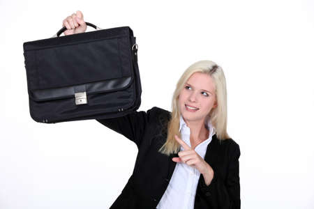 businesswoman holding a brief case Stock Photo - 13379137