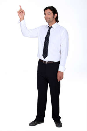 Man in a shirt and tie pointing upwards photo