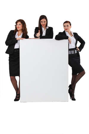 smug: Business women stood with blank message board