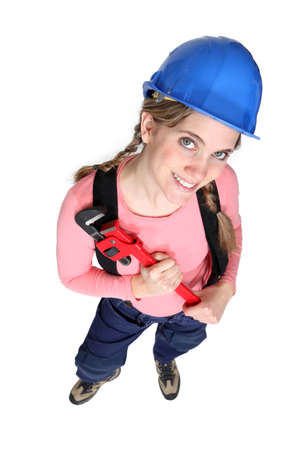tradeswoman: Tradeswoman holding a pipe wrench