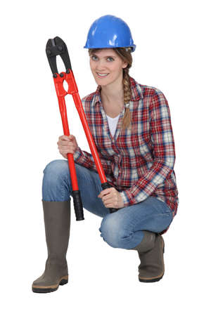 Woman crouching with bolt cutters Stock Photo - 13379084