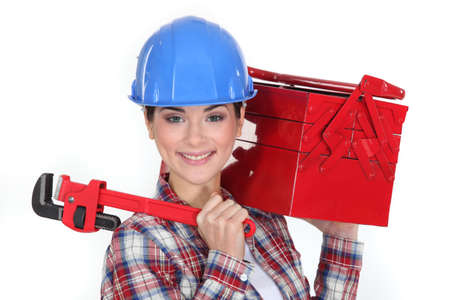 Happy woman carrying tool box photo