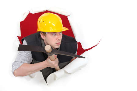 Construction worker with a pickax photo