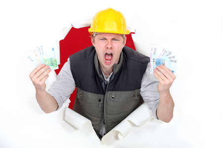 A male construction worker with plenty of cash  photo