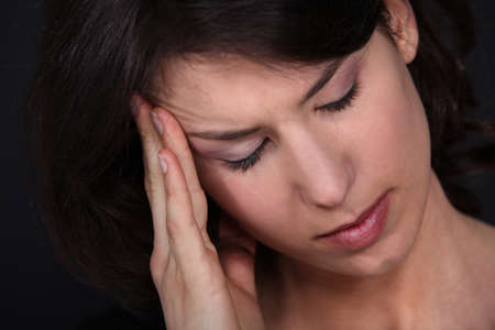 Closeup of a woman with a headache photo