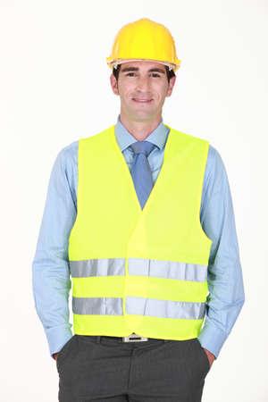 security vest: Man with helmet and reflective vest