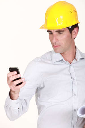 foreman reading sms Stock Photo - 13379354