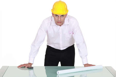 architect with determined gaze and arms resting on glass table Stock Photo - 13377459