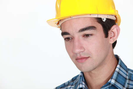 straight faced: Young construction worker with a neutral expression