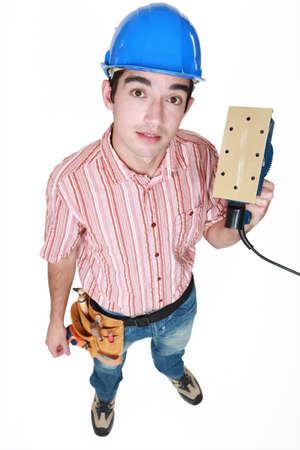 smoothen: Man holding an electric tool Stock Photo