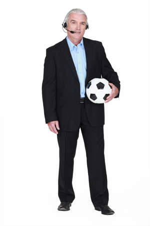 commentator: Football commentator holding ball Stock Photo