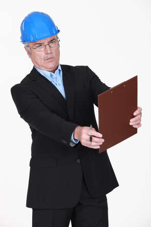 businessman looking critically at a report Stock Photo - 13378923