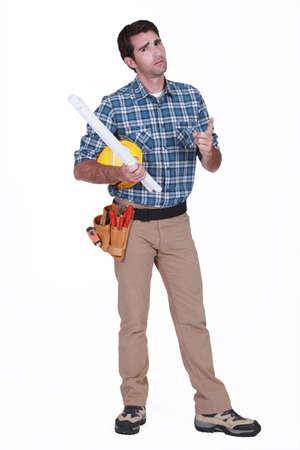 exasperate: portrait of carpenter looking disgruntled