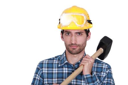 presslufthammer: Arbeiter mit einem Vorschlaghammer Lizenzfreie Bilder