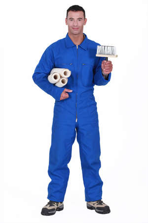 jumpsuit: Tradesman holding a brush and wallpaper rolls