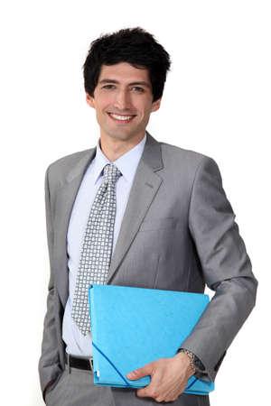 fascicule: Young businessman blue folder Stock Photo