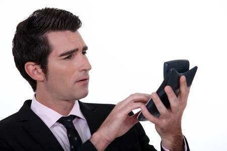 numerate: Businessman with calculator