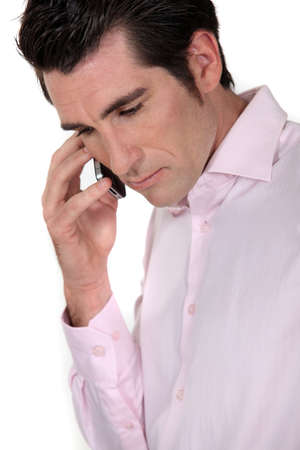 Seriously man phoning Stock Photo - 13379706