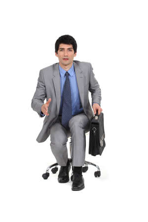 non verbal communication: Businessman holding his hand out for a handshake Stock Photo