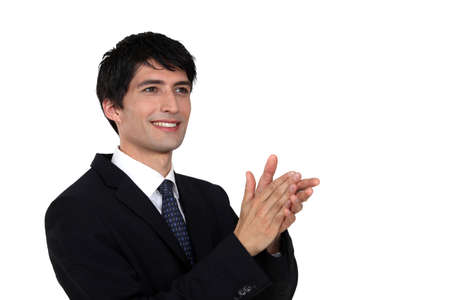 acclamation: Businessman clapping Stock Photo