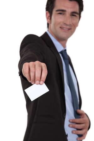 businessman giving his visit card Stock Photo - 13377732