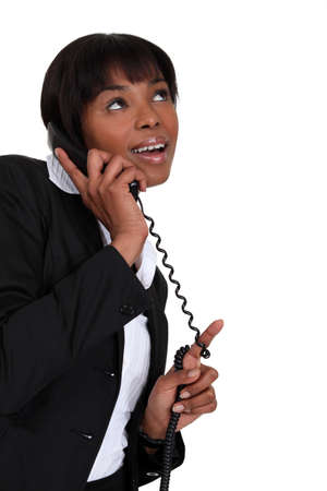 Smiling businesswoman on the phone Stock Photo - 13377897