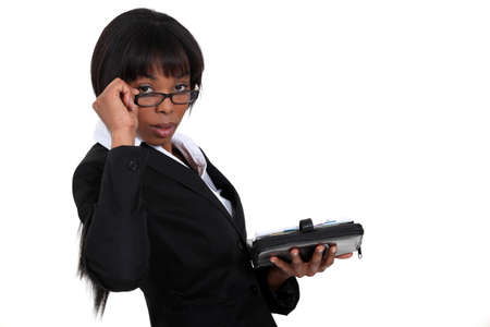 peering: Businesswoman peering over her glasses