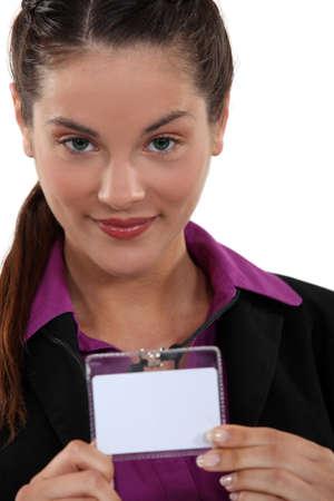 Woman displaying visitors badge Stock Photo
