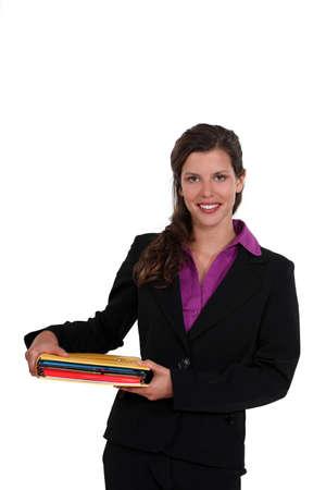 Brunette holding files Stock Photo - 13377524
