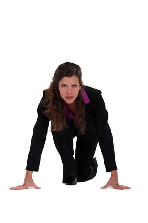 Businesswoman about to start foot race Stock Photo - 13377202