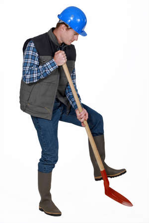 labourer: Labourer using a spade Stock Photo