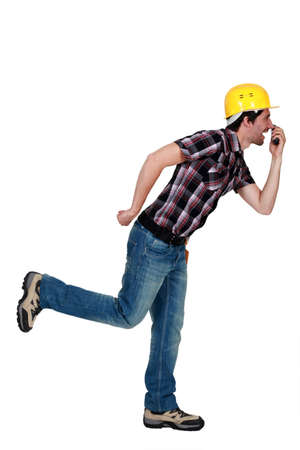 Goofy tradesman holding an object up to his nose