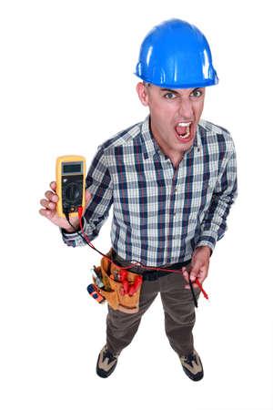 Man taking electrical reading Stock Photo