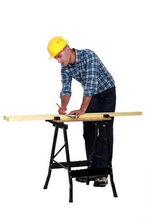 Carpenter measuring wood lath Stock Photo - 13377516
